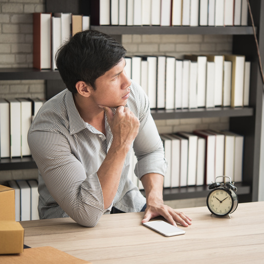 Young Man Sitting In A Home Office With Thinking. Sme, Owner Ent